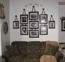 i needed to arrange the savvy family photos and after measuring the width of the wall dividing in half to find the center and measuring each frame moving