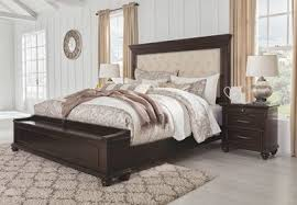 The Brynhurst Dark Brown <b>4 Pc</b>. King Upholstered Bed with Storage ...