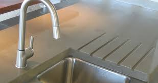 natural grey concrete countertops are popular in modern and contemporary kitchens adding an industrial look to these high end residential s