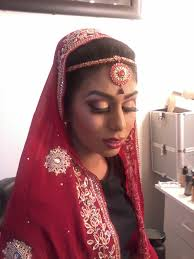 asian wedding look with gold and red