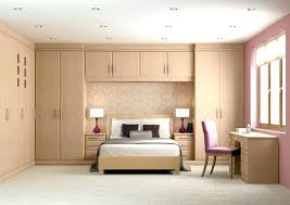 bed in wardrobe wardrobes bedroom storage brilliant design with brown wooden white bedding set on the middle wardrob