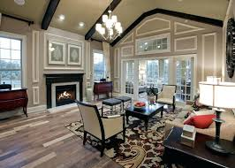 cathedral ceiling living room transitional living room with chandelier hardwood floors cathedral ceiling exposed beam carpet