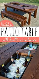 a wooden table with a built in cooler