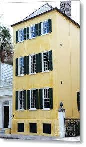 yellow house black shutters yellow houses metal print featuring the photograph french quarter historical district yellow