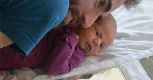 Childbirth: a father's-eye view   Robert Heaton