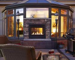 permalink to awesome two sided indoor outdoor fireplace