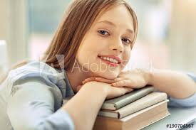 student sitting at desk hands folded. Exellent Sitting Relaxed Student Beautiful Teenage Girl Posing For The Camera While Resting  Her Chin On Intended Student Sitting At Desk Hands Folded
