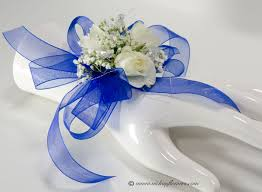 prom 024 25 plus tax and delivery blue wrist corsage with white spray roses es breath silver wire and bright blue ribbon