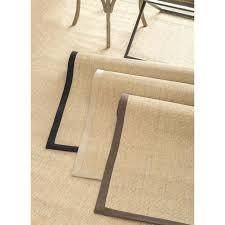 black rug with white border beige