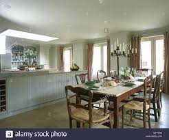 Traditional country kitchens Kitchen Cabinets Traditional Country Kitchen Painted Units Central Island Unit Wood Table Chairs Interiors Kitchens Kitchendiner Diners Skylight Mixed Styles Old And Alamy Traditional Country Kitchen Painted Units Central Island Unit Wood