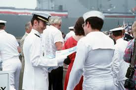Cwo Navy Chief Warrant Officer Cwo Don Slicer Hands A Program To A Sailor
