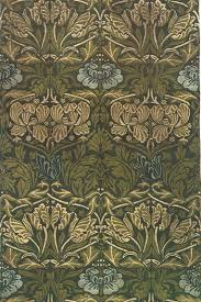 large green leaves and blue flower rug by william morris