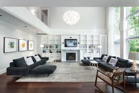 Charming Dark Grey Sofas And White Built In Fireplace Cabinets For Storage  In Large Modern Grey Living Room Ideas