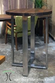 custom round black walnut table top on stainless pedestal base for chicago restaurant