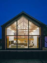 Inspiration for a contemporary one-story glass gable roof remodel in Other