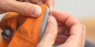 placing a new zipper stopper on a jacket zipper