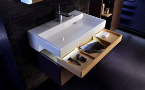 so simple so clever the cantilevered basin of the terrace sink provides cover for a drawer that s partitioned to those little toilette necessities
