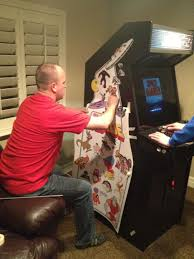 by now my arcade cabinet was out of the wood and inside the house already getting plenty of play by my sons the lit up marquee and pleted monitor