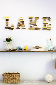 learn how to make this diy painted driftwood lake sign