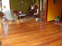 a 100 year old heart pine floor red