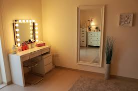 small white wooden vanity desk with mirror and lights in the corner