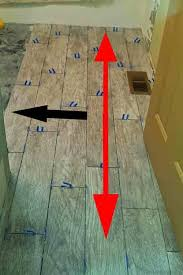 laying ceramic tile wood floor