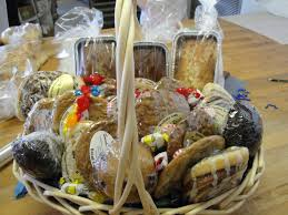 of pound cake 1 loaf of banana bread 3 gift bags of granola gift bags of mixed nuts 5 cinnamon rolls 8 cookies and decorative cans