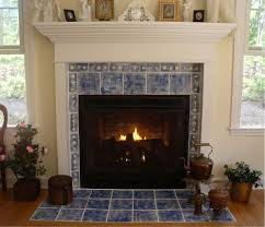 interior white fireplace mantel with blue tile around and white shelf also blue tile hearth