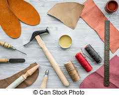 Work desk of clobber skin and tools on grey wooden desk pictures