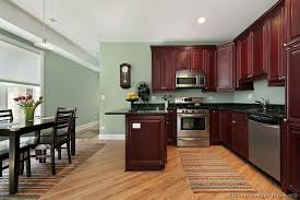 green paint colors for kitchen kitchen features traditional rich cherry cabinets light green walls popular green green paint colors for kitchen