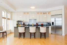 should you refinish your kitchen cabinets or replace them all together