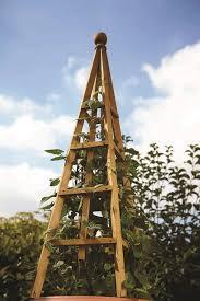 large wooden garden obelisk by garden