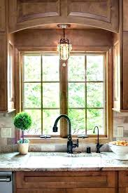 light above kitchen sink height of pendant