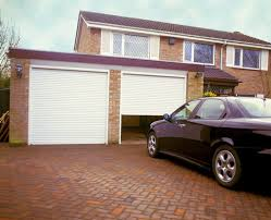 Two Car Garage With Brick Walls And Automatic Doors - Awesome ...