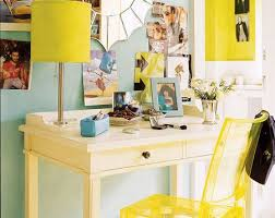yellow turquoise blue fun office design with yellow lucite acrylic ghost desk chair yellow shade on silver lamp and soft blue green walls in the girls amazing yellow office chair