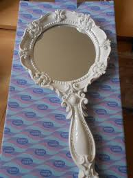 hand holding antique mirror. boudoir white vintage style hand held mirror bedroom dressing table accessories holding antique