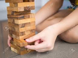 Game Played With Wooden Blocks Closeup Of Asian Kid's Hand Playing Wood Blocks Stack Game Stock 61