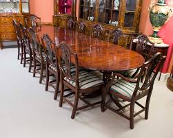 a magnificent antique regency dining table and set of 12 chairs circa 1900