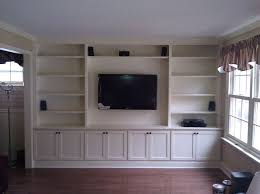Built-In with Wall Hung TV traditional-living-room