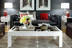 black tufted sofa canada image by interior design living room modern with area rug
