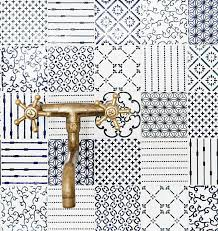 blue and white kitchen backsplash tile style varies from flowers and folk figures to geometrics