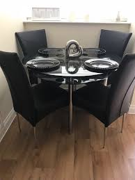 round glass table chairs