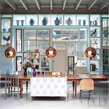 designers often use suspended lighting in groups of three to highlight a key aspect of a