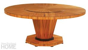 the aspen table in chilean tineo and ebonized cherry has a built in lazy susan
