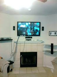 how to hide tv wires in wall above fireplace mounting above fireplace hiding wires images of