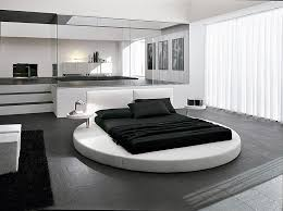 A modern and contemporary twist on the circular bed is combining the bed  frame with a square mattress. It creates quite a dramatic effect