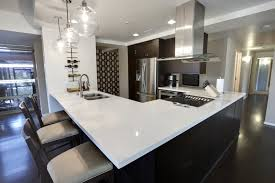custom kitchen island ideas. This Sleekly Contemporary Kitchen Sports Dark Hardwood Flooring And Cabinetry Tones To Match, With A Custom Island Ideas T