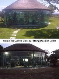 curved glass frameless folding stacking doors