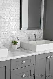 Charming White Bathroom Cabinets With Dark Countertops Including