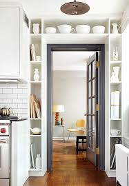 (via Remodelista) black door and trim surrounded by built in shelving (via  Remodelista)